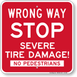 Wrong Way Stop Severe Tire Damage Sign