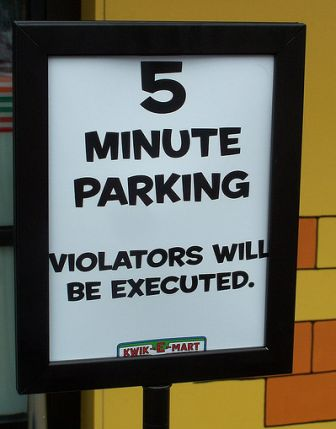 Violators executed parking sign