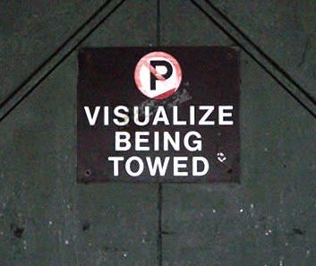 Visualize being towed parking sign
