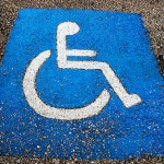Signs vs. stencils: what are the ADA requirements for disabled parking spots?
