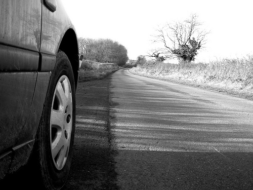 black and white car on country road
