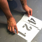 How to stencil parking lot identification numbers