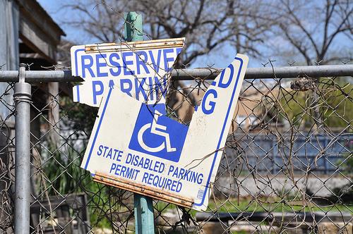broken disabled parking sign