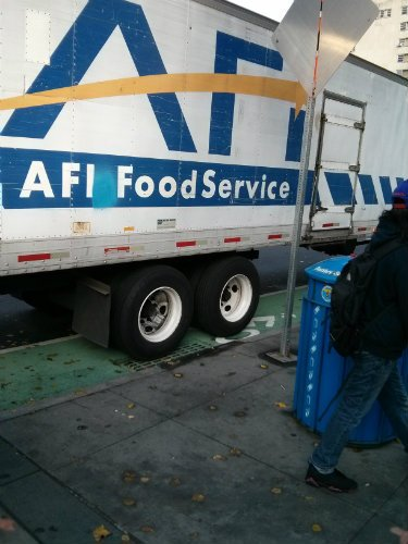 AFI truck unloading on bike lane