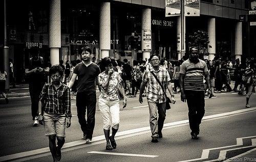 Pedestrians crossing road in Indonesia