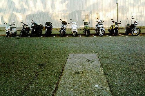 Scooters parked in special parking spots