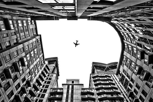 airplane between buildings