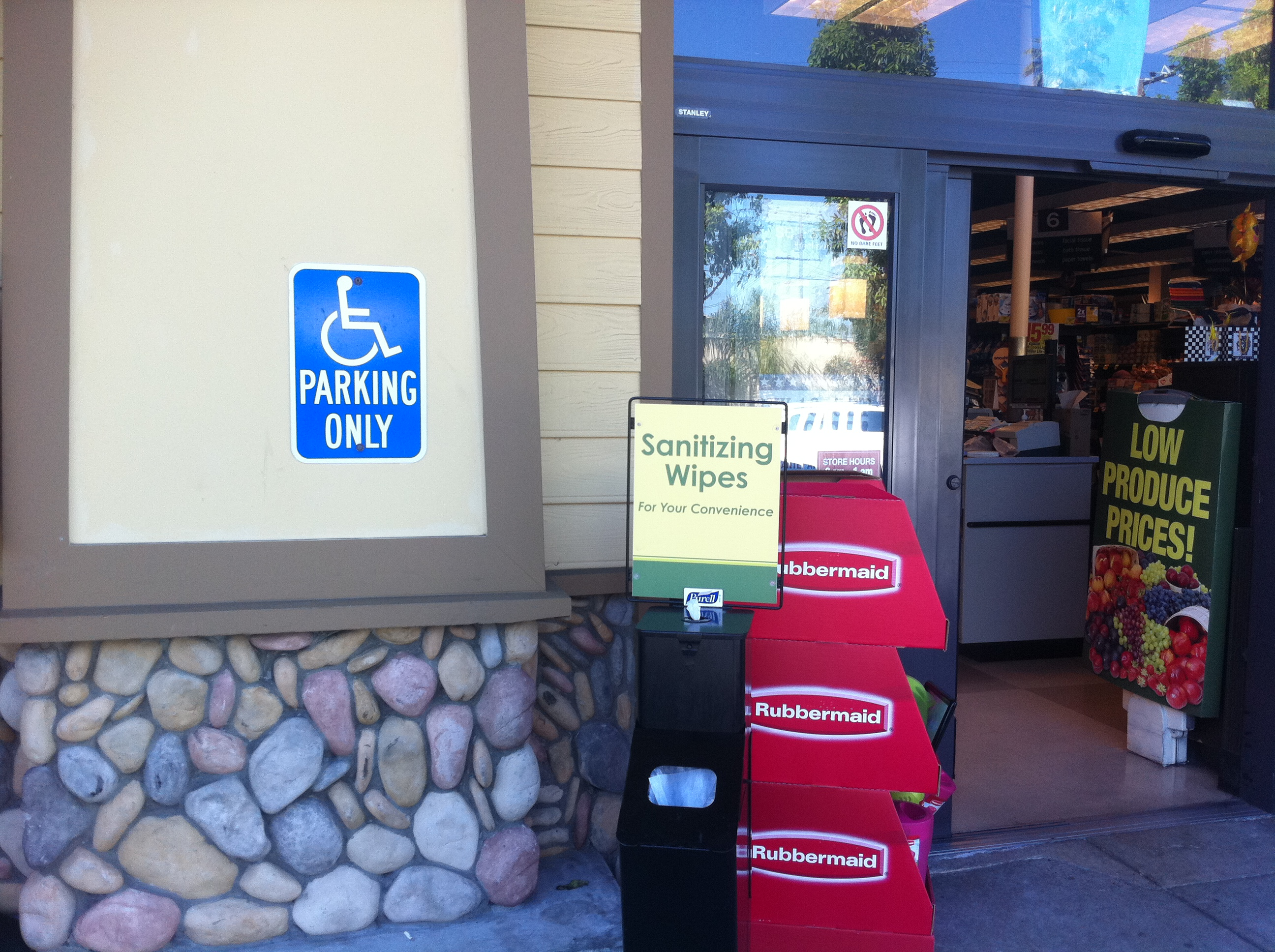 handicapped parking sign by storefront