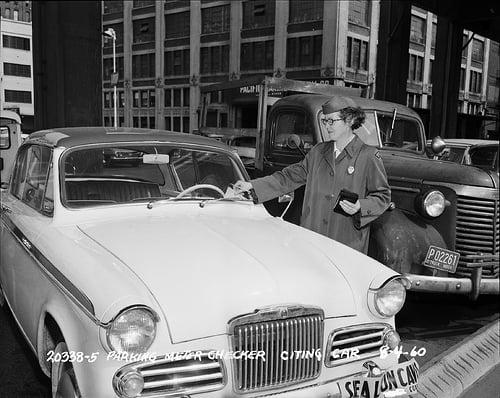 Seattle parking attendant writing ticket 1960