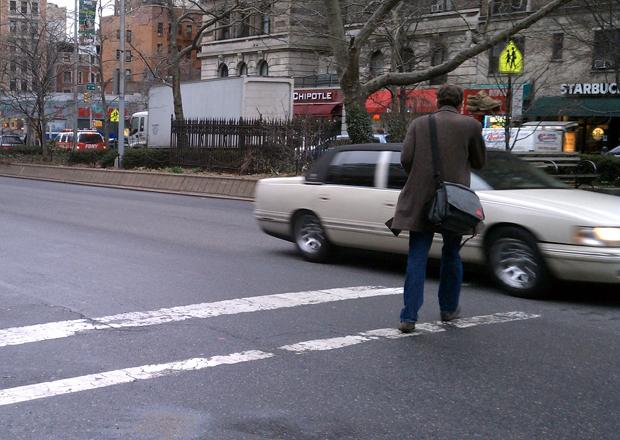 A pedestrian crossing Broadway